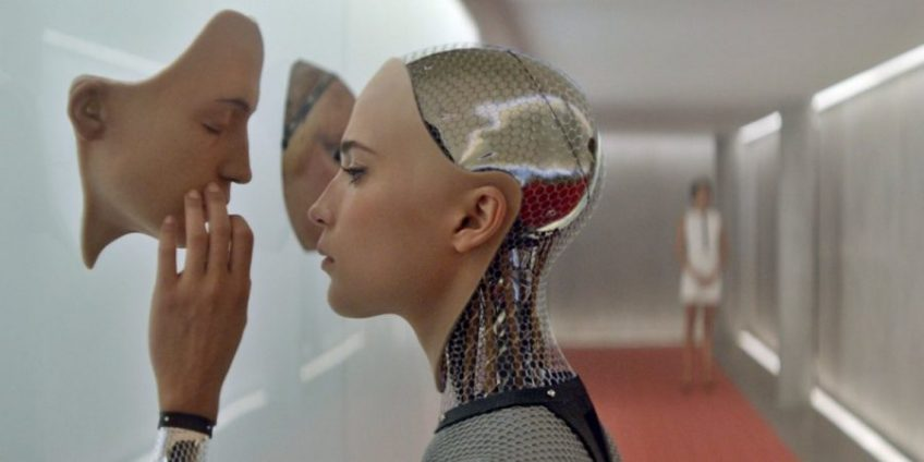 A screenshot from the Ex Machina movie in which an android picks a face for itself