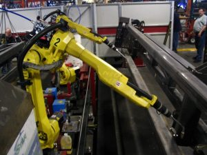 A photo of a robot in a factory