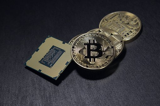 Coins with a bitcoin logo on them and a processor