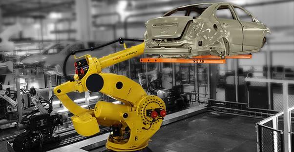 A photo of a robot manufacturing a car
