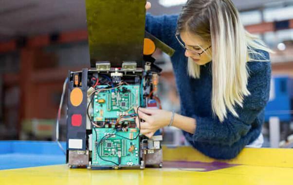 A woman building a computer
