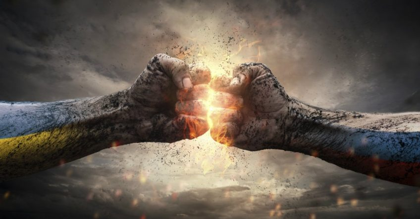 Two fists clash and create a spark