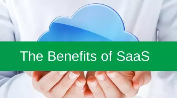 A person holding a cloud in their hands on which The Benefits of SaaS is written