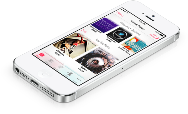 A silver iPhone with the iTines radio app dashboard