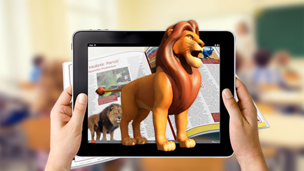 two hands holding a tablet from which a digital illustration of a lion emerges